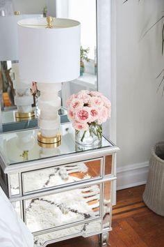 Pretty mirrored bedside table: http://www.stylemepretty.com/living/2016/04/04/8-steps-to-a-stunning-home-makeover-on-a-budget/   Photography: Matt Harrington - http://mattharrington.photo/: