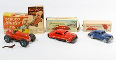 Lot 479: Chevrolet Back Motion Tin Wind-up Car with Original Box; Together with a Schuco Studio 1050 with original box and accessories and automobile with siren friction car with original box