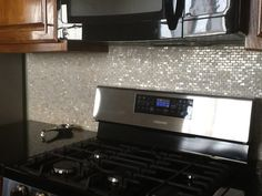 White Mother of pearl tile backsplash -