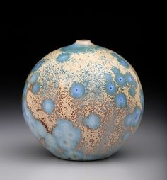 I am trying to be able to make the crystals look fractal and this one has the beginnings of it. These crystalline pots are all fired one or two at a time so I can learn from the results and hopefully make the right changes. http://www.tiltonpottery.com/gallery.php#56