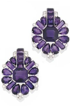 A PAIR OF ART DECO AMETHYST AND DIAMOND CLIP BROOCHES, BY CARTIER. Each of…