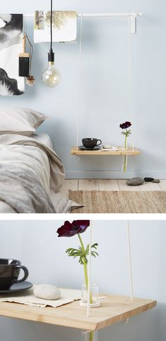 A DIY hanging bedside table made from a chopping board and rope with a hole drilled in to hold a thin glass tube vase