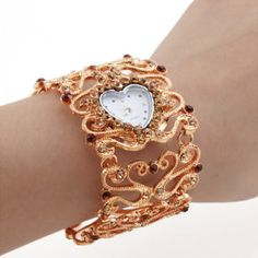 This pretty gold bracelet watch is accented with coffee-colored crystals.