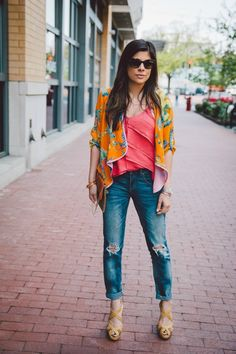 Style Tip: Dress up distressed jeans with a colorful tank and bolero, fabulous heels, and a stylish clutch   STYLE'N