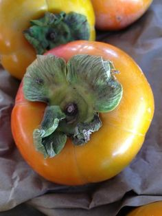 Persimmons have arrived at the Farmers' Market! This is a fuyu persimmon~the kind you can eat firm (Photo from Farmers Market Fairy, Twitter @farmersmktfairy )