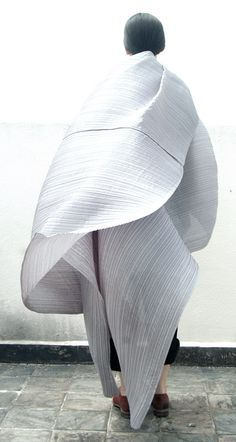 Voluminous Fashion with fine pleated textures and loose drape; sculptural fashion design // Issey Miyake