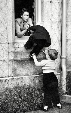1952: The Queen helps Prince Charles and Princess Anne climb through a window