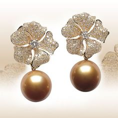 South Sea golden pearl, diamond and 18k yellow gold earrings.