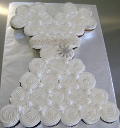 Oh-My-Soul Cookies & Cakes  Wedding Dress Cupcakes!  Vanilla, Chocolate and Strawberry Cupcakes with Fluffy Vanilla Frosting, Adorned with a Sugar Crystal band and broach.  http://shop.ohmysoulcookies-cakes.com/