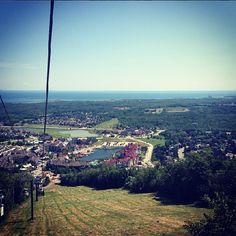 Summer Weekend Getaway at Blue Mountain Ski Resort on Instagram - Riding up the mountain in a gondola. You can see Georgian Bay from up here  #familytravel #skiresort #familyatblue #ontario #canada