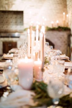 Candlight. White Candles. Photography : Hunter Ryan Photo Read More on SMP: http://www.stylemepretty.com/living/2016/12/09/a-cozy-candlelit-holiday-gathering/