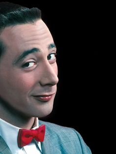 Pee Wee Herman gives a knowing look.  Classic Pee Wee expression.