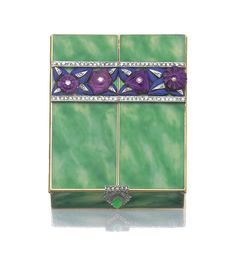 Enamel, gem-set and diamond powder compact, 1928 - the enamel lid applied with a floral and foliate frieze of amethyst, lapis lazuli and rose diamonds, thumb piece accented with diamonds centring a cabochon green gemstone, opening to reveal a similar frieze in blue and red enamel, and a powder compartment with a mirror, mounted in gold.