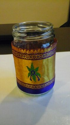 Jar decorated with fabric scraps