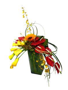 diseño floral curvilineo con minicallas, anturios y orquideas dendrobium amarillas