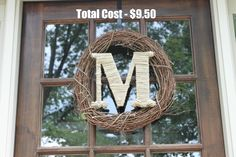 M from Hobby Lobby - $2, Wreath - $3.50 - Walmart, Twine - to wrap letter - $4 - Walmart.  Total - $9.50 - love it!