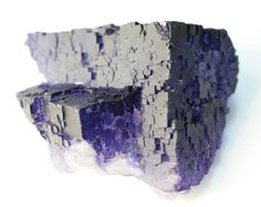 Intergrown cubes of highly detailed, beautifully colored, deep purple Fluorite from Melchor Múzquiz, Coahuila, Mexico. This locality has produced some of the most stunning cubic purple fluorite to ever come out of Mexico. The intergrown cubes have moderately developed stepped-growth faces with sharp edges. This particular piece has a pretty amazing structure of steps with many lustrous crystal faces. Beautiful piece!