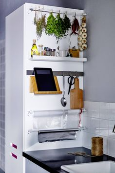 small kitchen storage design, by attaching rails, shelves and hooks to the side of a cupboard. Its stainless steel 'Rimforsa' rail, holds everything from cooking utensils and chopping boards to tablets. Ikea Design, Storage Design, Home Design, Storage Ideas, Diy Storage, Organization Ideas, Storage Rack, Storage Solutions, Clever Design