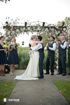 white wedding arch at Vista West Ranch, hydrangea, babies breath and add white garden roses, white dahlias, and white daises