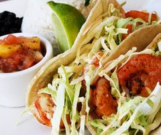 Cilantro Lime Shrimp Tacos finished with a chipotle slaw and fresh avocado served w/fresh mango salsa Red Onion Café 214 S. Main Street Monroe, Ohio 513-360-0180