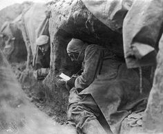 Ww1 • A Soldier in a trench during the first world war writes letters home • 1914