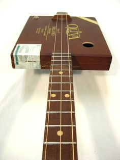 Oliva 3 String Cigar Box Guitar  Walnut, Birdseye Maple and some Sapele used on this one. Sharp lookin' and playin' 3 String.