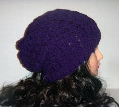 This hat has a textured braid design all the way to the top. The color is just lovely in a dark purple color called eggplant.  Color: Purple ( eggplant) Material: 100% soft acrylic yarn Size: Will fit adult head Care instructions sent with every item.