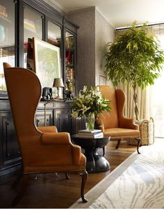 Fabulous by Thom Filicia ... Brown leather upholstered wingback chairs with nailhead trim