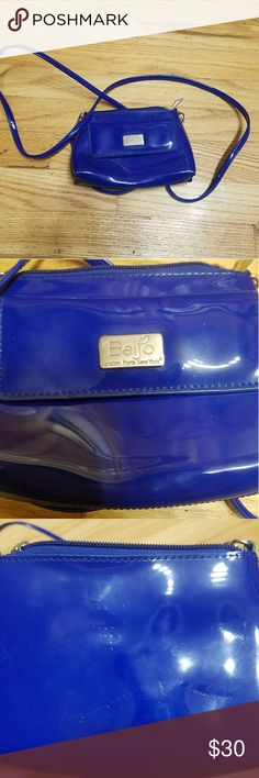 Blue Beijo Purse Electric blue small Beijo Purse. Only used once small dents on the back. Comes in a protective cloth bag. 110  Buy one regular item, get a 🔴LAST CHANCE🔴 item for free! Add both items into a bundle and send me an offer of the regular item price! Have questions? Ask:) Beijo Bags Crossbody Bags
