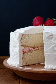 White cake with strawberry filling and strawberry-vanilla buttercream frosting. #recipe