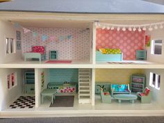 Dolls house makeover - you should see the before shots!  This was given a makeover for my class at literally no cost....I just used some leftover scraps of fabric and paint to freshen it up.  :-)