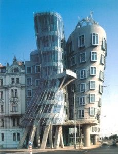 Tančící dům/Dancing House. Frank Gehry. A bit biased because I lived down the street from it in Prague.