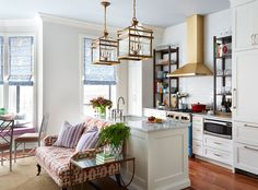 Kitchen with brass hood. Home Tour: Summer Thornton Project in Chicago. Lonny