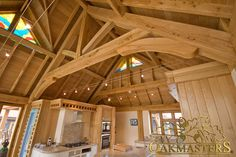 Traditionally crafted king post oak truss with rafters.