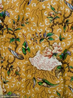 Augusta Auctions Tasha Tudor Coll.  Seaweed and floral print on mustard ground :dress dates to 1830-35
