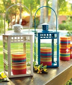 cute way to spruce up lanterns...used colorful candles inside. great indoor or outdoor summer accent!