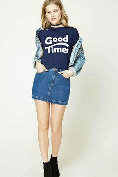 """A boxy tee featuring a """"Good Times"""" graphic, round neckline, and cuffed short sleeves."""
