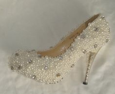 Make to order hand sewing pearl shoes Ivory. $199.00, via Etsy.