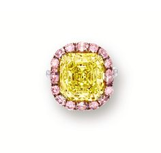 FANCY VIVID YELLOW DIAMOND, PINK DIAMOND AND DIAMOND RING.  Centring on a square emerald-cut fancy vivid yellow diamond weighing 13.10 carats, framed by circular, oval and marquise-shaped pink diamonds together weighing approximately 1.80 carats, the mount and shoulders decorated with circular-cut diamonds, mounted in 18 karat white and pink gold.