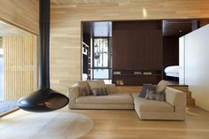 forest-getaway-cabin-dominated-by-warm-wood-boards-9-living-room.jpg