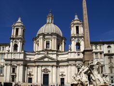 https://flic.kr/p/caotpb   Rom, Piazza Navona, Sant'Agnese in Agone und Fontana dei Quattro Fiumi (Fountain of the four rivers)   An der Stelle der Piazza Navona befand sich das antike Stadion, das 82 - 85  unter Domitian errichtet worden war und das athletischen Übungen und Reiterspielen diente.  Die Kirche Sant'Agnese in Agone, die sich nahtlos an den Palazzo Pamphilj anschließt, wurde Mitte des 17. Jh. von Francesco Borromini erbaut. Sie ist die Gedenkstätte für de Märtyrerin Agnes, die…