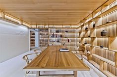 The project is a three-story townhouse located in a residential area in the eastern suburbs of Beijing. The first floor and the basement are a connected spac...