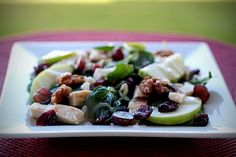 Baby Spinach (spring mix or baby greens work just as well), Feta Cheese (you could use blue cheese, goat cheese), Apples, Dried Cranberries, Candied Pecans or Walnuts, cooked & chopped chicken, Poppy Seed Dressing      Other items you can add…. pomegranate seeds, grapes, strawberries, raisins, pears…