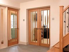 Beautiful oak glazed doors bring light into this home's hallway. Wooden Glass Door, Wooden Door Design, Internal Double Doors, Internal Wooden Doors, Door Entryway, Entrance Doors, Living Room Divider, Doors And Floors, External Doors