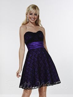 Stunning A-line dress, scoop neckline with stylized pleating at center of bodice. Ruched waistband, short length skirt, zipper back closer. Lace & Satin 22580 prettybridesmaids.com