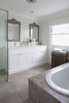 Tiled bathroom floor with smaller tiles around tub from The House that A-M Built