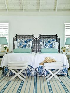 Push together twin beds for guest room versatility. I love these cane-and-rattan headboards and matching X benches. #guestroom #Xbench #blueandwhite