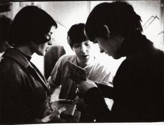thateventuality:Scan - Paul McCartney and George Harrison signing yet more autographs, 1963 Photo: Terence Spencer George Harrison, Sehun, Exo, Life Magazine, Paul Mccartney, The Beatles, Couple Photos, Books, Fictional Characters