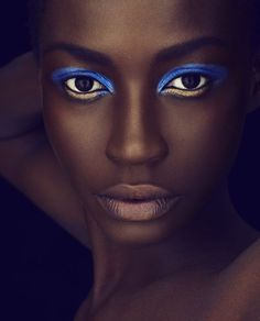 Bold signal-blue pencil/ shadow, with gold accent under the eye, shimmery neutral lip-colour.