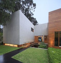 "Concrete and Steel ""House H"" in Lima Built Around a Sunken Garden - http://freshome.com/2015/03/10/concrete-and-steel-house-h-in-lima-built-around-a-sunken-garden/"